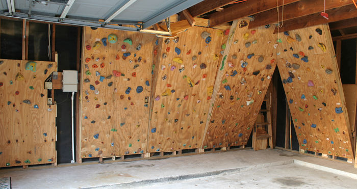 home built home made climbing wall in our garage